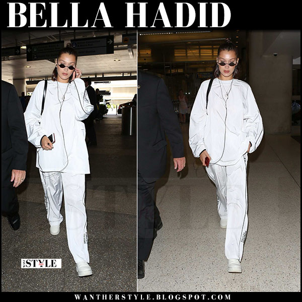 Bella Hadid in white tracksuit hyein seo and white sneakers what she wore june 21 2017 lax