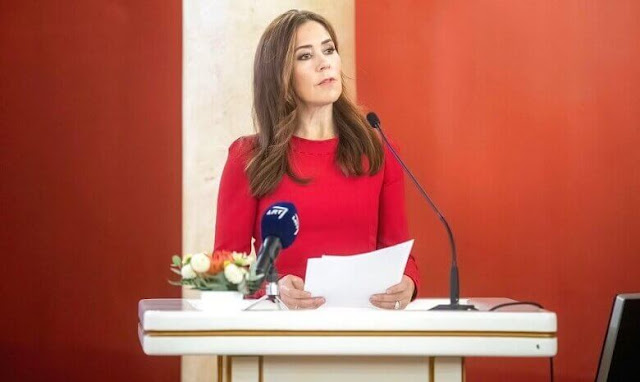Crown Princess Mary a red contrast-stitch cady dress from Dolce & Gabbana, and double cashmere oslo coat from Joseph