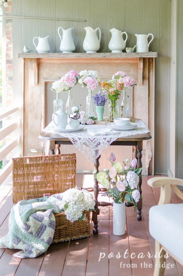 summer flowers and lace with vintage items on wood table