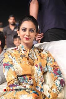 Actress Rakul Preet Singh Stills in Short Dress at Dhruva Pre Release Function  0020.JPG