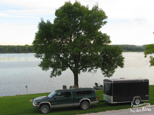 Builder Bob's truck and trailer parked in front of our house by the Mississippi River