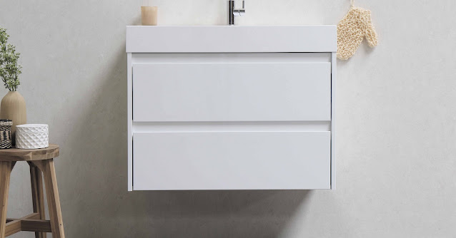 White floating vanity in a white bathroom providing better bathroom accessibility.