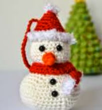 http://media.blacksheepwools.com/media/wysiwyg/crochet_snowman1.pdf