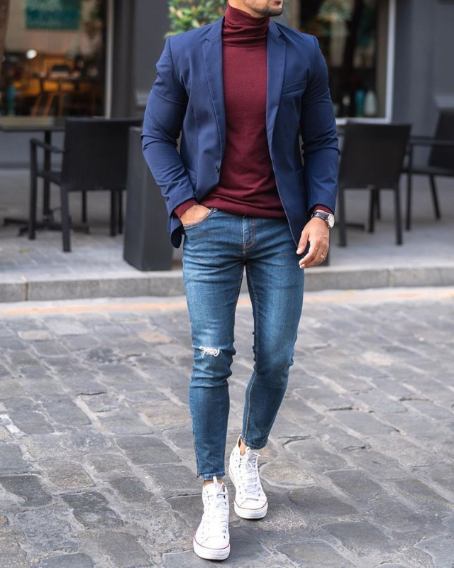 Men in Blue blazer and highneck with blue jeans.
