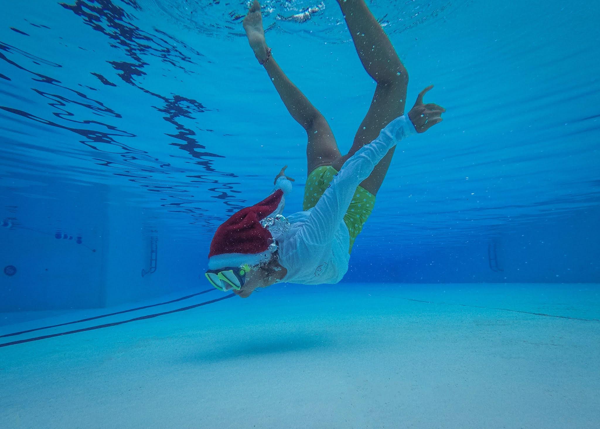 Swimming and spending Christmastime underwater