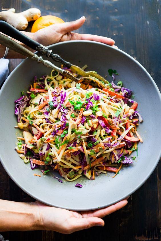 Thai Noodle Salad with Peanut Sauce- loaded up with healthy veggies and the BEST Thai Peanut Sauce EVER! Vegan & Gluten-Free | www.feastingathome.com |#thainoodlesalad #vegan #thainoodles #peanutsauce #peanutdressing #veganthainoodlesalad #vegansalad #mealprep #asiannoodlesalad #thairecipes #thaipeaunutsauce