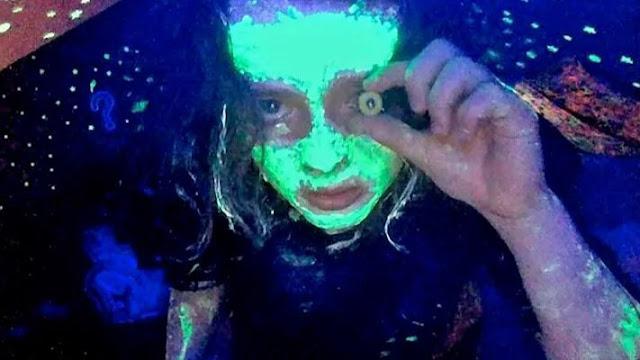 creepy green face