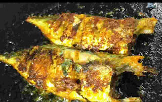 Crisp golden two full fish fry on the pan or tawa