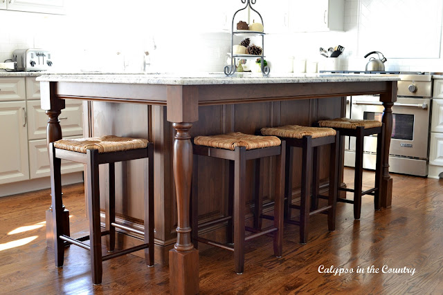 Cherry island with counter stools on side and end