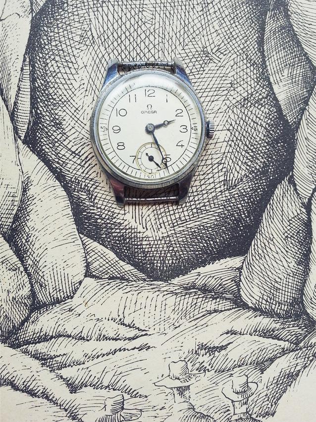 """Zegarek na tle książki Juliusza Verne'a """"Wyprawa do wnętrza Ziemi"""" z 1979 roku, ilustracje: Daniel Mróz."""