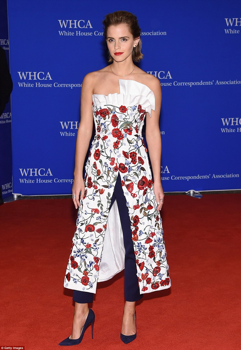 Emma Watson wears a strapless floral look for the White House Correspondents' Dinner