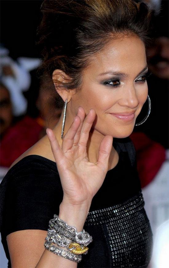 7f1681299 Jennifer Lopez in hoop earrings and multiple bracelets. Photo Source:  http://www.barkevs.com/blog. December 12, 2012