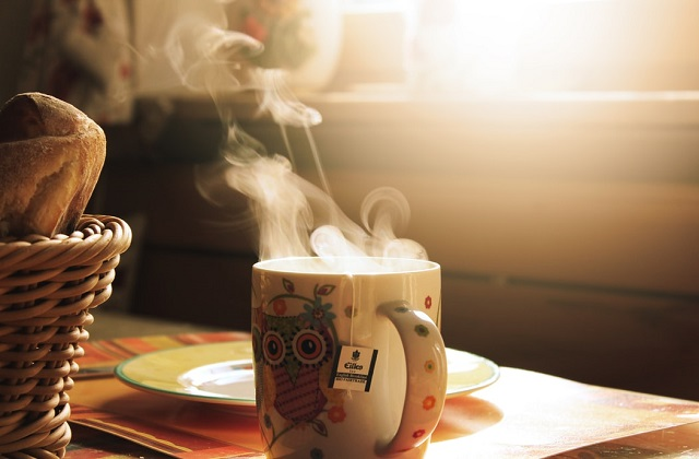 tea in an owl cup steaming hot