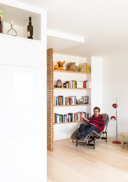 Person reading a book in a reading corner of living room