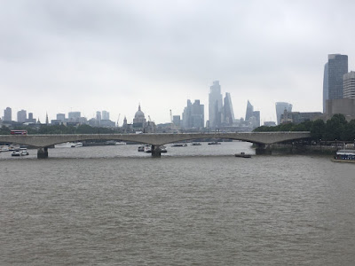 photo of London skyline - looking over River Thames , with St Pauls cathedral in the distance
