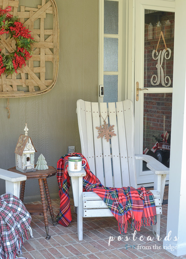 white adirondack chair with red plaid blanket for Christmas