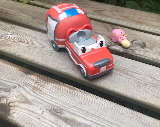 fire engine playset on a garden bench