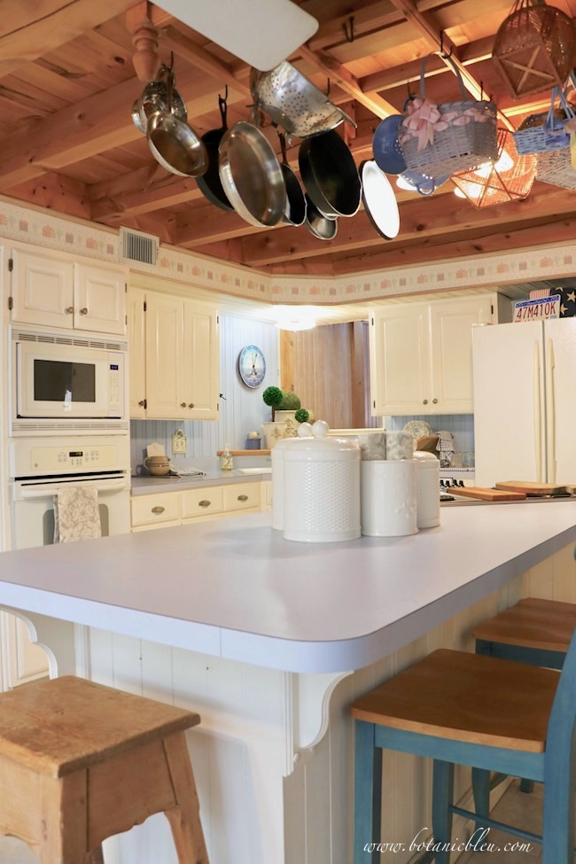 French Country Kitchen in a Post and Beam House Goes Summer to Fall