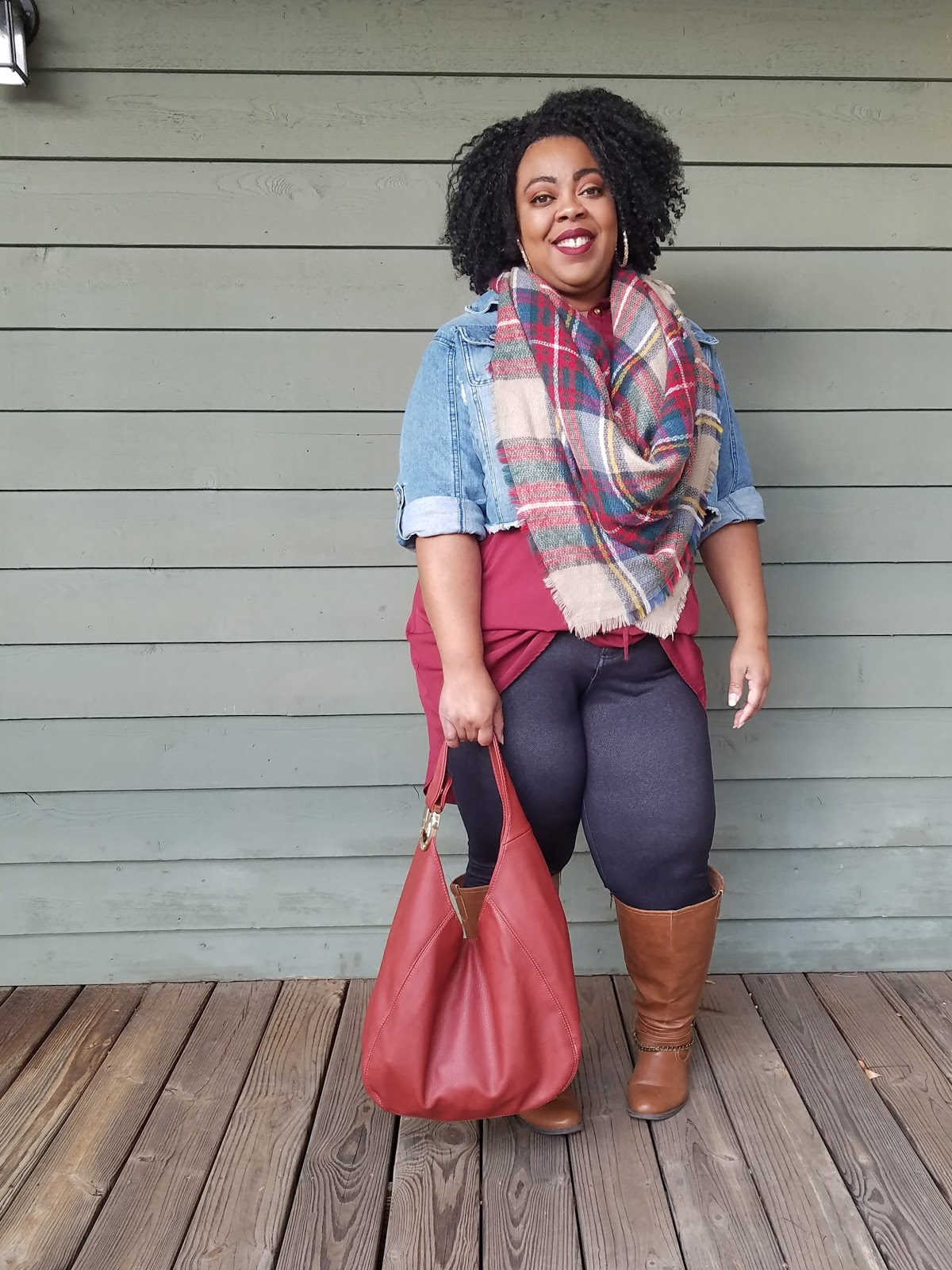plus size model, denim jacket, plaid, tartan, blanket scarf, hobo bag, tall boots, natural hair, berry lipstick