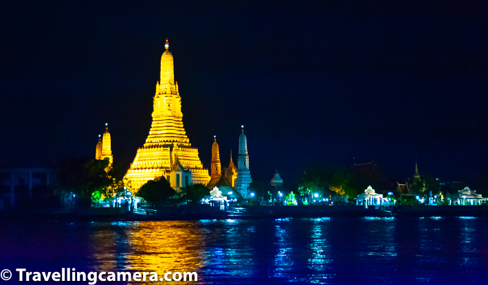 Above photograph show Wat Arun from other side of the river. It looks beautiful during night with these amazing lighting arrangements. Wat Arun is visible as you walk a little towards the rive from Wat Pho. There are various restaurants on other side of the river where you can sit and enjoy your meal by looking at this wonderful view of Wat Arun & it's well lit reflection in river water.      Related Blogpost from Thailand - Train Journey from Bangkok to Aayutthaya in Thailand  Wat Arun can be easily accessed through the Chao Phraya River and ferries travel across the river towards the Maharaj pier. For foreigners, the temple charges an entrance fee of 50 baht. And you can have such a brilliant view of the temple without paying a single Baht :).      Related Blogpost from Bangkok, Thailand - Bangkok Flower Market - Pak Khlong Talat, Thailand
