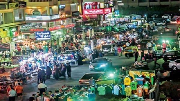 """الشرطة المصرية تشن حملة كبيرة للحد من العشوائيات على""""شارع السوريين"""""""