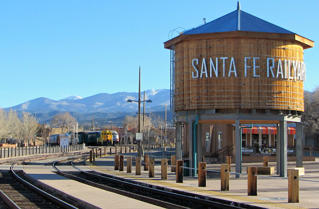 the RailRunner train and snow covered mountains in Santa Fe