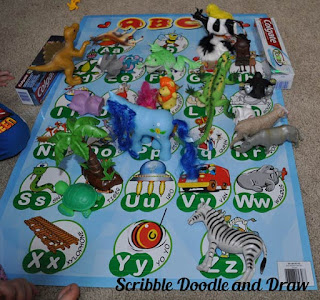 Learn beginning letter sounds with toy animals and an abc poster