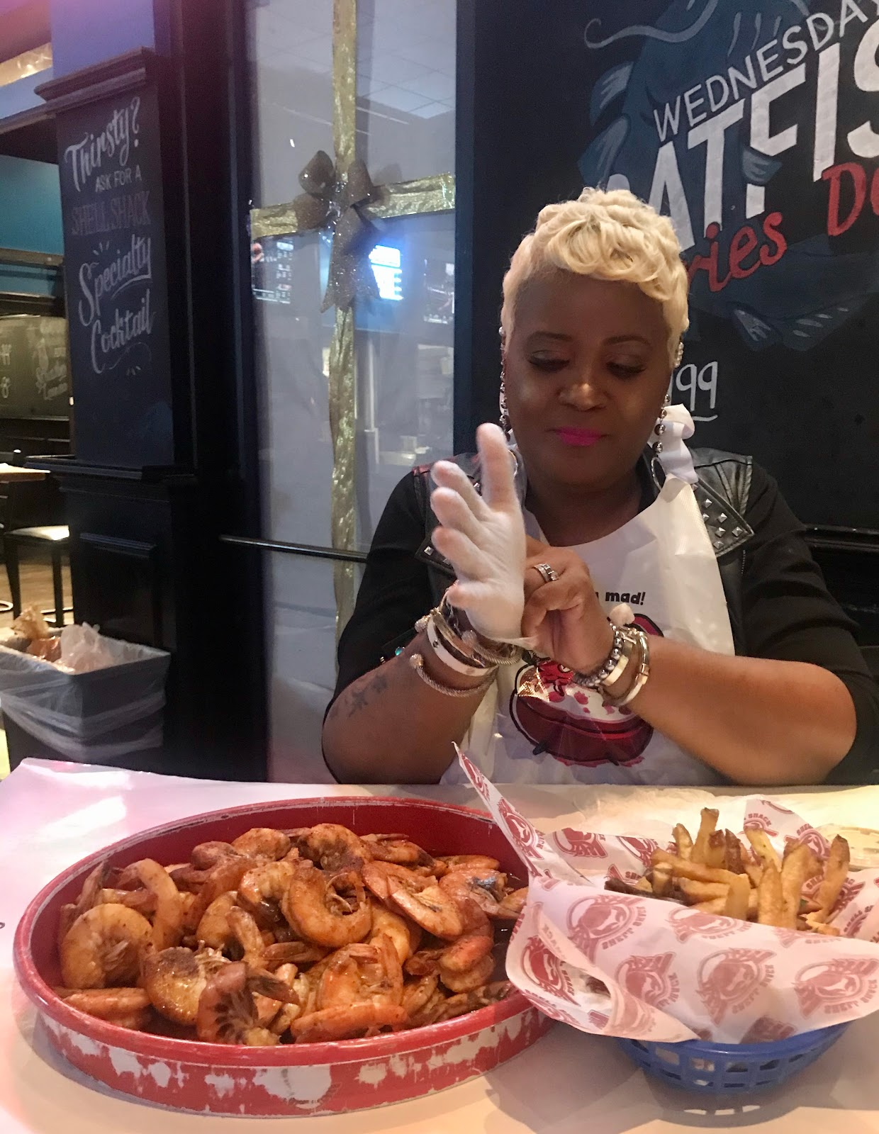 Tangie eating at shell shack crab shack in Dallas Texas
