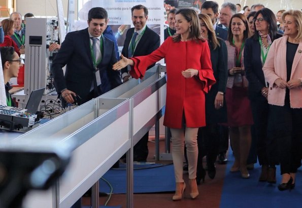 Queen Letizia wore Zara frilled sleeve coat and wore Lodi Saray Pumps, she carried Carolina Herrera red python clutch at AndalucíaSkills event