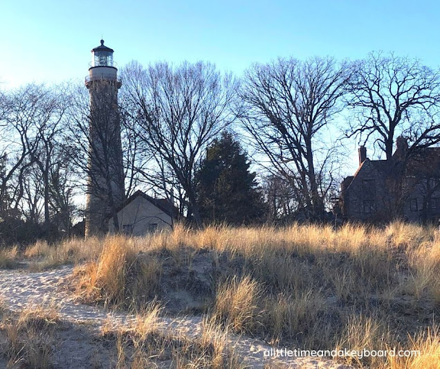 Grosse Point Lighthouse rises above the dunes.