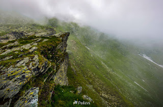 Steep Slope On Rocky Hillside In Fog