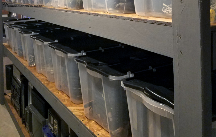 how to build free standing shelves in the basement - shelves packed with plastic clear totes with split tops