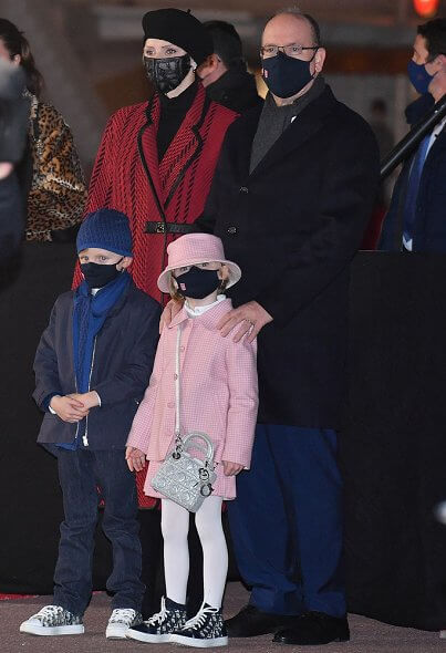 Princess Charlene wore a new leather-trimmed wool-blend tweed coat from Akris. Princess Gabriella wore a tweed jacket and skirt from Jacadi, Dior