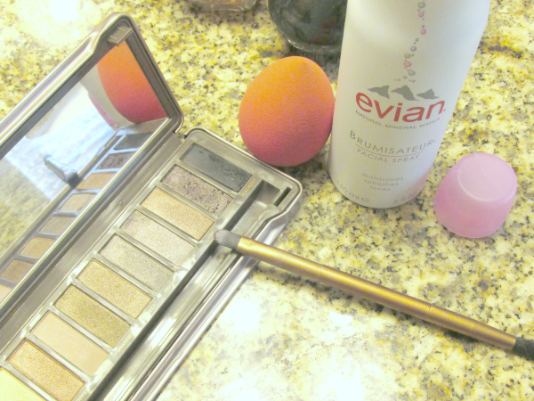 use of evian facial spray with eyeshadow