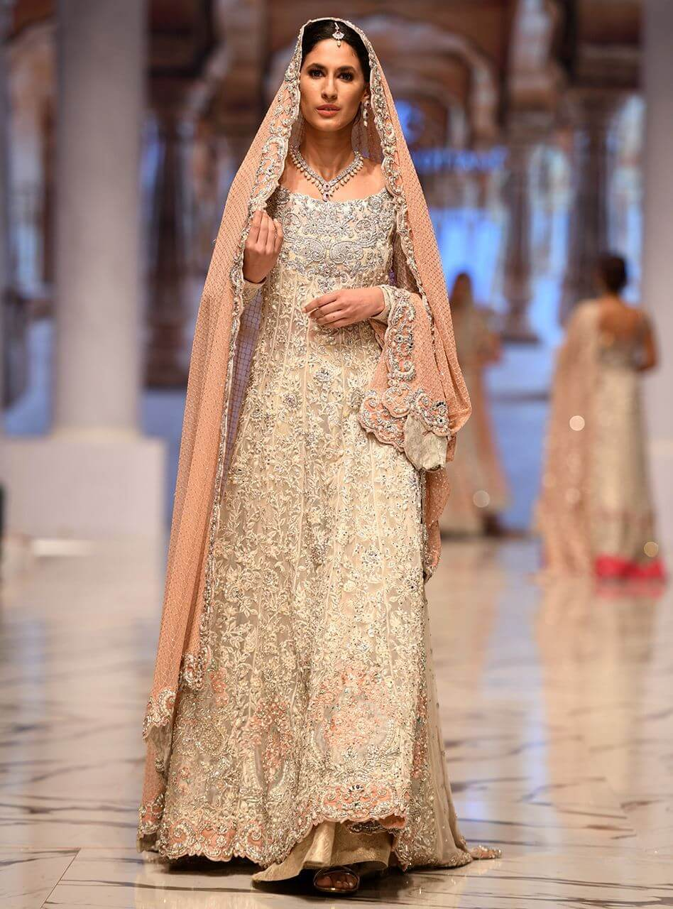 Elegant Ivory Bridal Gown by Zainab Chottani embellished with pearls and silver kundan kora dabka
