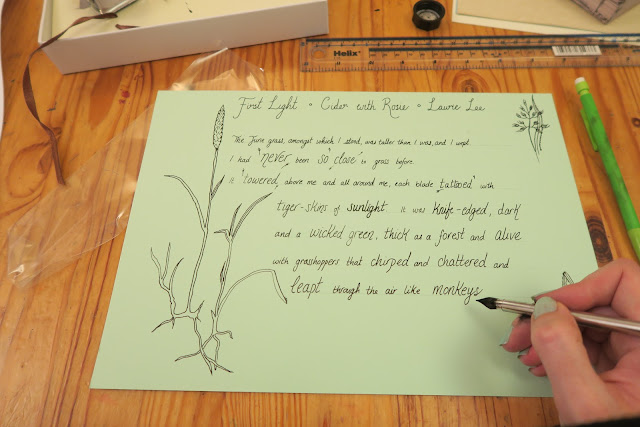 at work using calligraphy pen