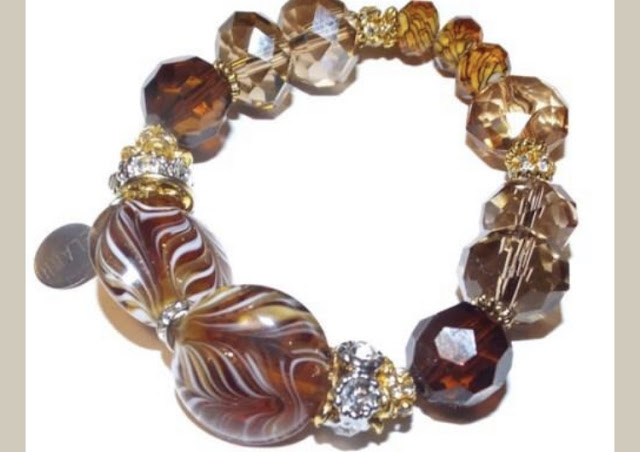 https://www.andreawagnerdesigns.com/products/beaded-bracelet-rondelle-crystal-beads-with-rhinestones-boho-chic-stretch-bracelet-the-amber-bracelet