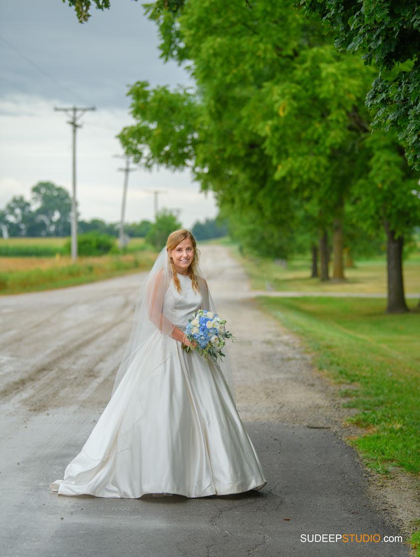 Rustic Farm Wedding Photography in Saline Dexter Bride in Dusty Muddy Road Jeep Barns by SudeepStudio.com Ann Arbor Wedding Photographer