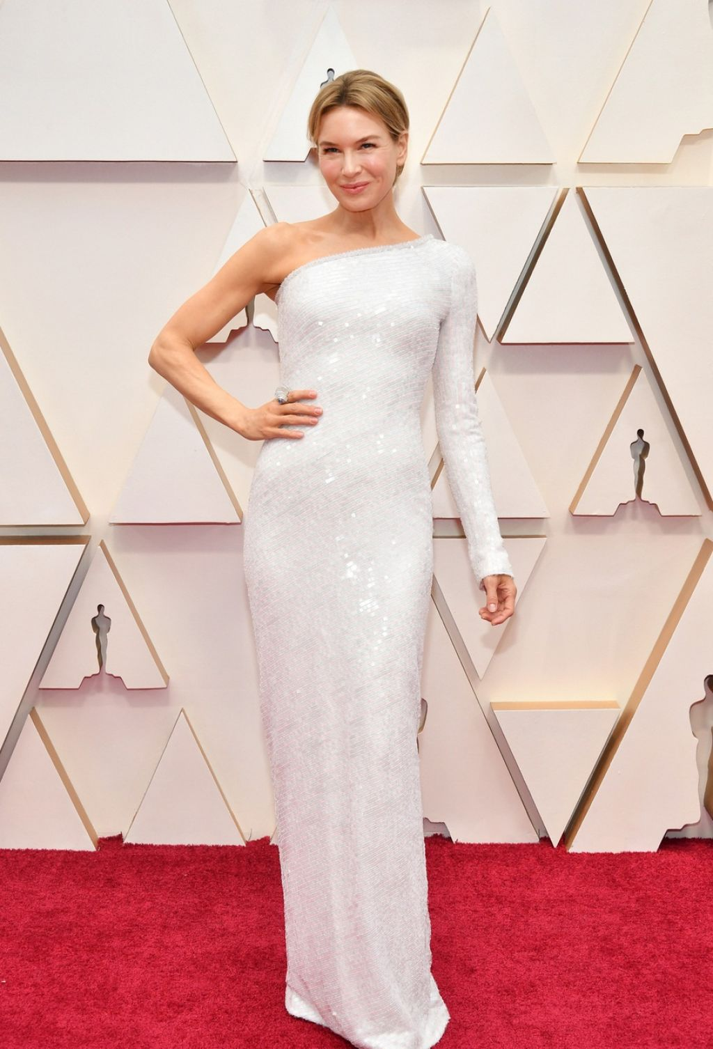 Renee Zellweger sparkles in white hot body hugging one shouldered Oscars red carpet