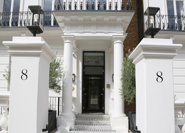 The Laslett Hotel white exterior entrance in Notting Hill in the heart of West London
