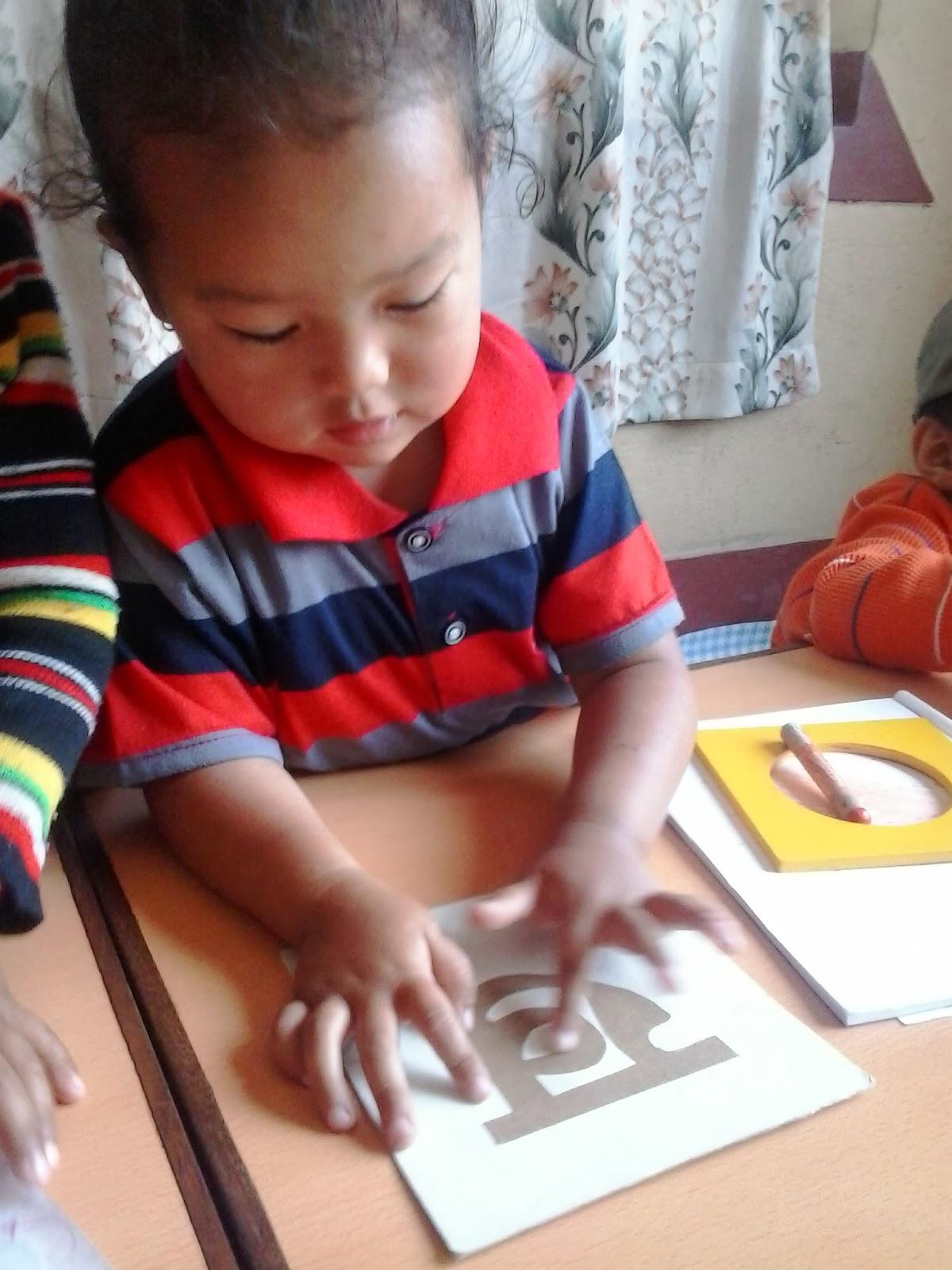 Happy Crayons School Teaching Nepali Alphabets To