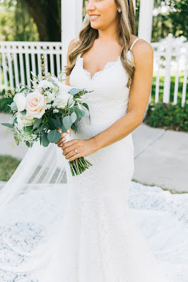 bride in lace wedding dress and bouquet