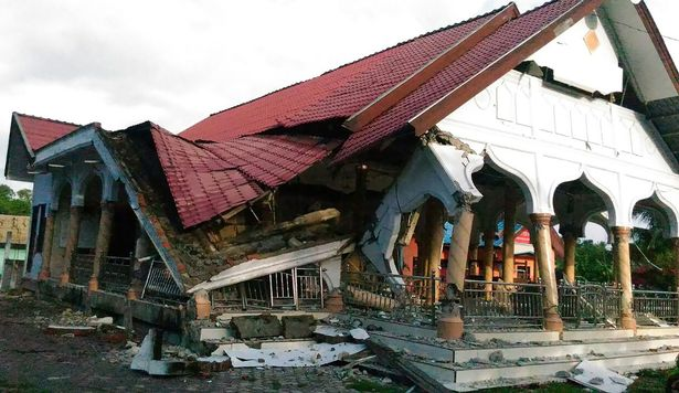A-badly-damaged-building-is-seen-after-a
