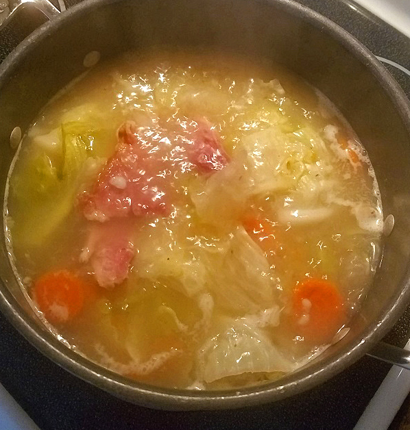 this is  how to make homemade soup with ham cabbage potatoes and carrots.