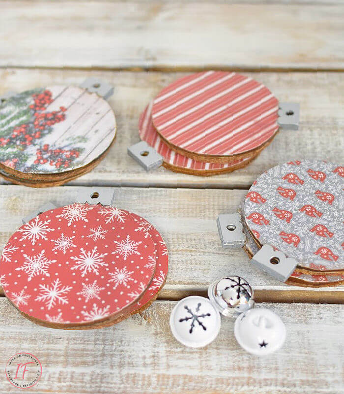 These festive DIY Christmas Drink Coasters are an easy and inexpensive decoupage craft with dollar store wood ornaments and festive scrapbook paper.