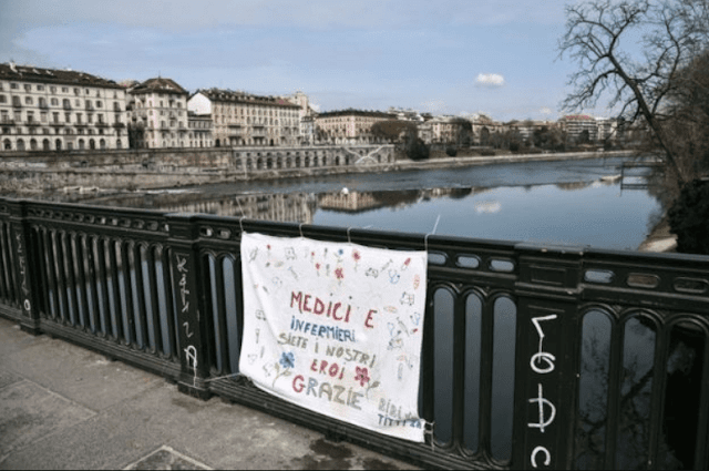 Doctors and nurses are our heroes, thank you, reads a sign hanging on the Vittorio Emanuele bridge in Turin.
