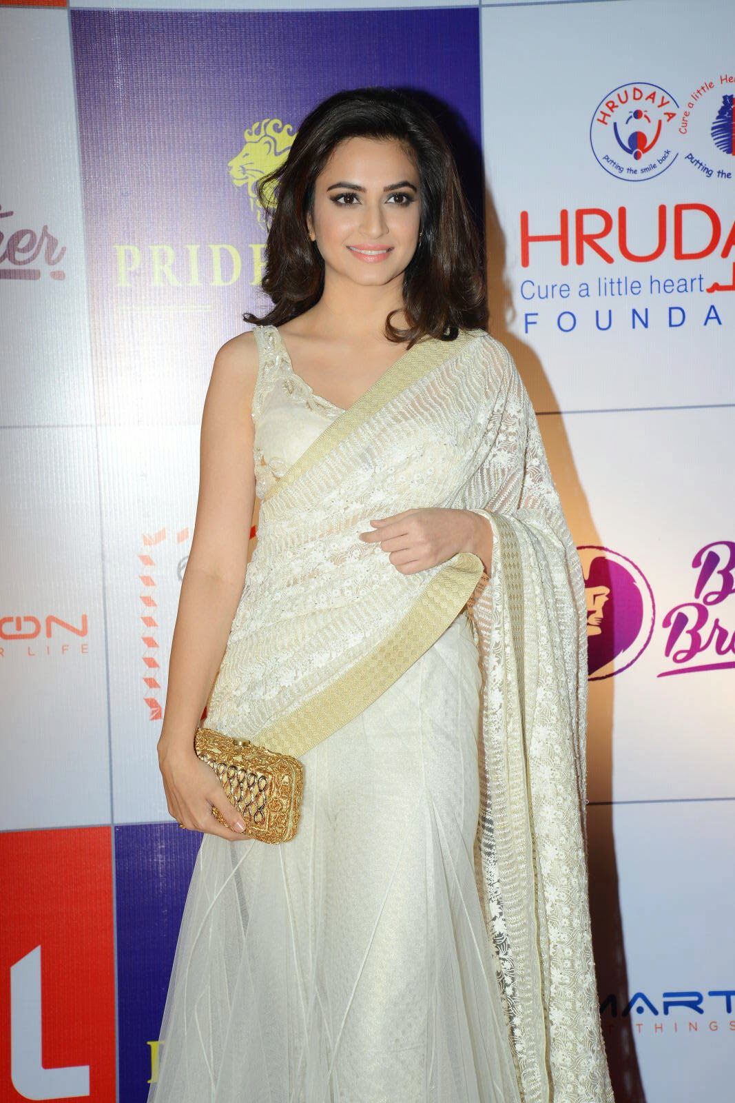 Actress Kriti Kharbanda Latest Cute Hot White Transparent Saree Navel Show Spicy Photos Gallery At CCL Charity Dinner