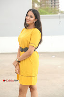 Actress Poojitha Stills in Yellow Short Dress at Darshakudu Movie Teaser Launch .COM 0058.JPG