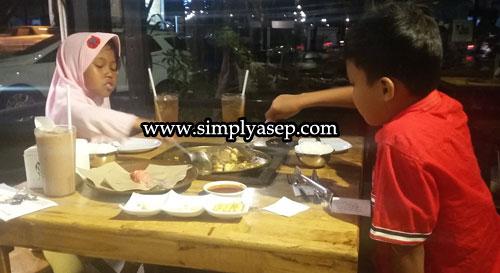 My children enjoying their dinner at Grillme Pontianak