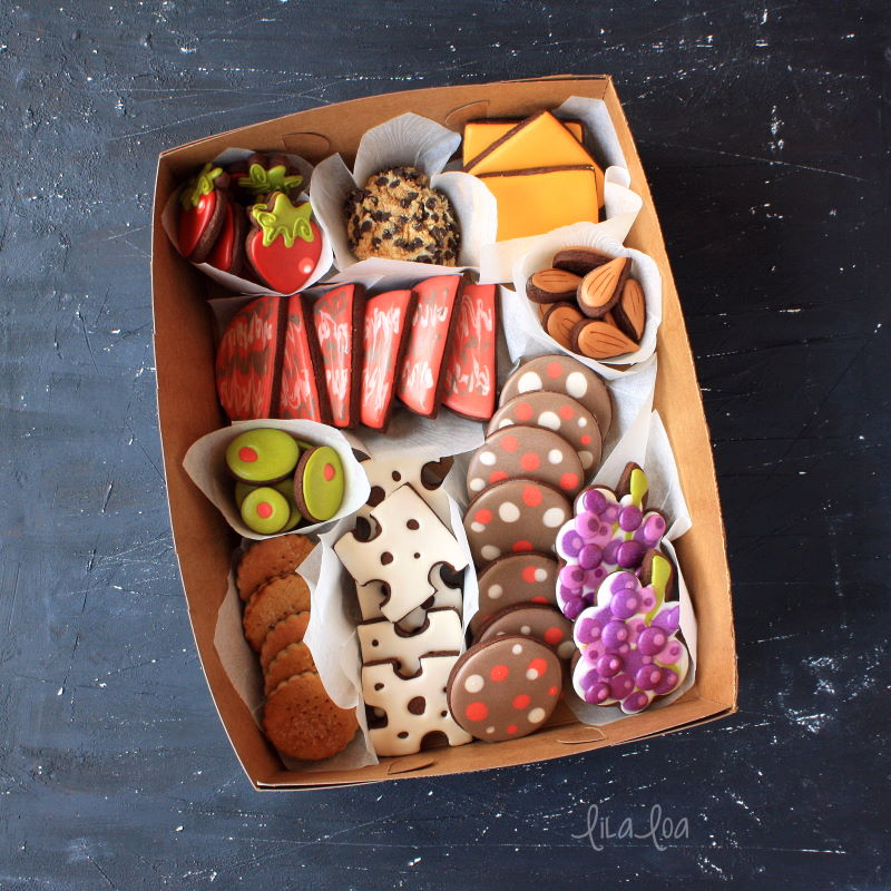 Decorated chocolate sugar cookies that look like a charcuterie board